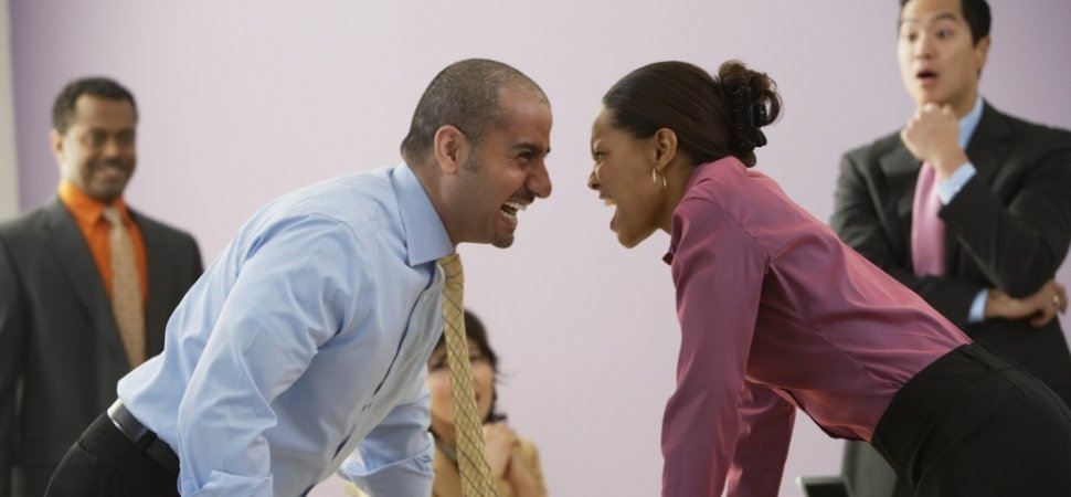 man-and-woman-colleagues-argue