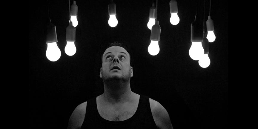 man-looking-at-bulbs
