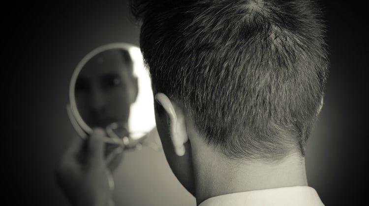 man-looking-at-mirror