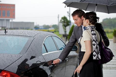 man-opens-car-door-for-woman