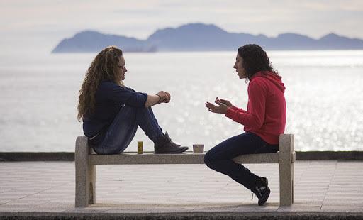 two-women-talking-by-the-sea