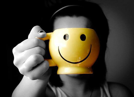 woman-holding-a-smiley-mug